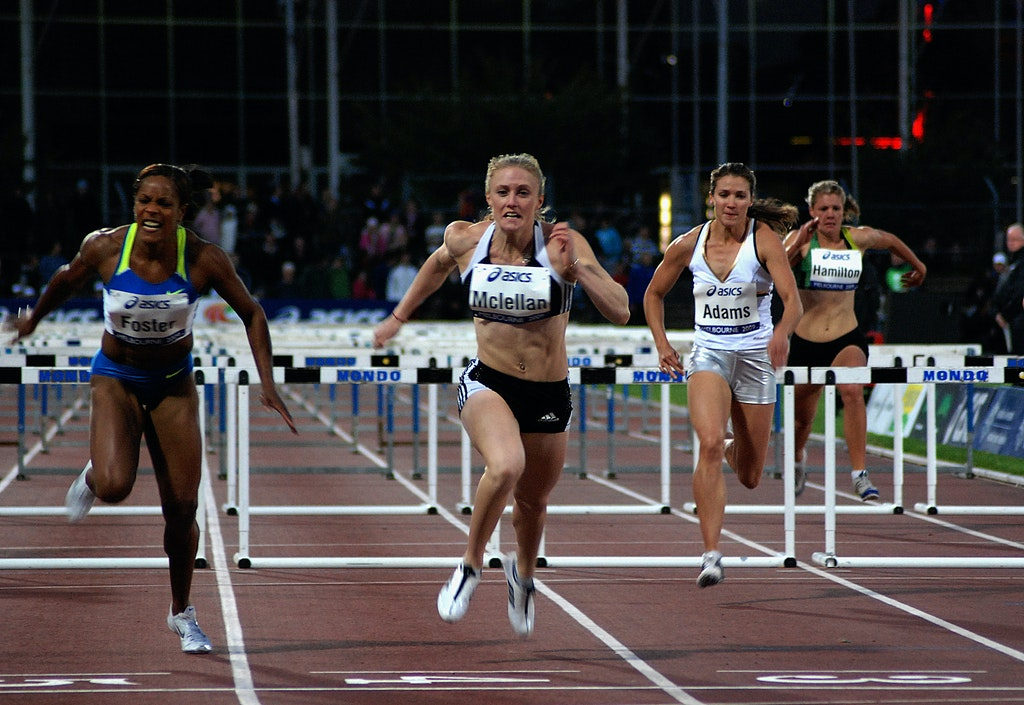 Sally McLellan - Sally McLellan leans at the line for a 13.06 second victory ahead of Jamaica's Brigitte Foster in the 100m hurdles at the Melbourne leg...