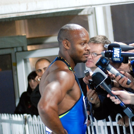 Media Pack - Asafa Powell speaks to the media in the mixed zone following his victory in the 100m at the 2009 World Athletics Tour meet in Melbourne.