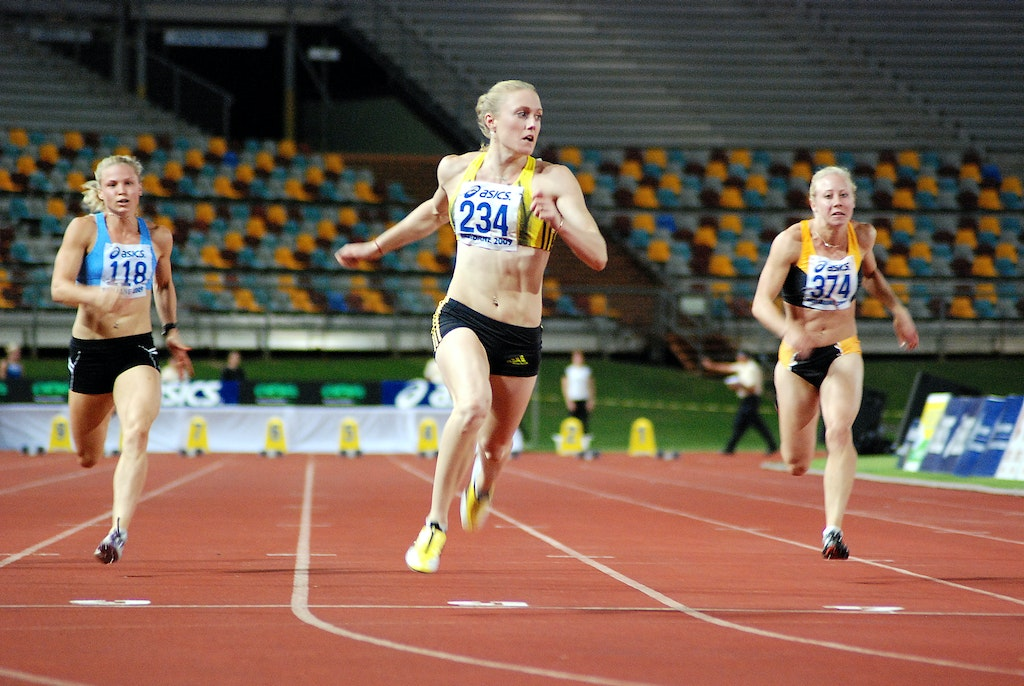 Smooth running from Sally - Sally McLellan relaxes after crossing the line for an easy 11.40 second (+0.1) win in the heats of the 100m at the 2009 Australian...