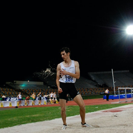 Too easy - Fabrice Lapierre brushes away sand after a leap in the long jump at the 2009 Australian Championships. In a thrilling competition Lapierre took...
