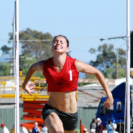 Laura Whaler - Laura Whaler (red) competing in the heats of the women's 120m at the 2009 Stawell Gift.