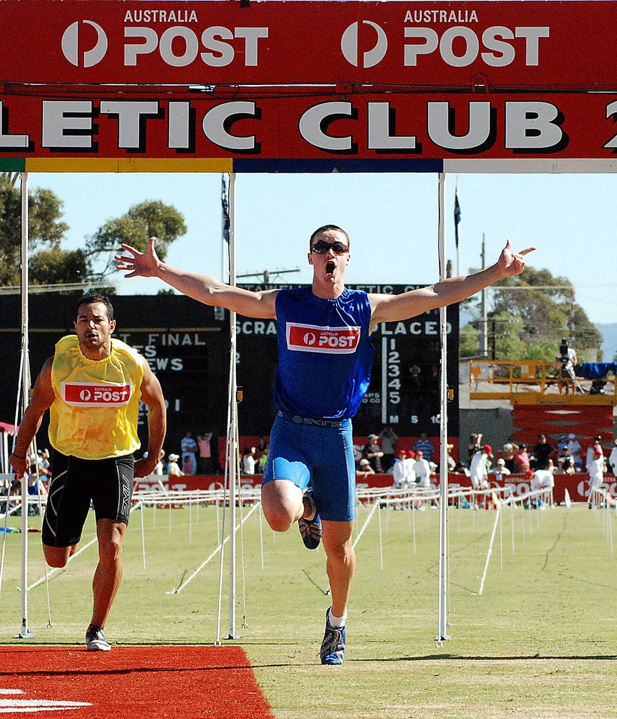 Stubbs celebrates - Aaron Stubbs crosses the line for victory in the 2009 Stawell Gift.