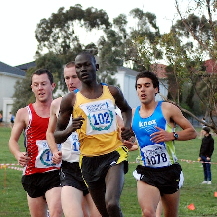 Lead Pack - Duer Yoa leads Liam Adams and Kane Willie in the 2009 Victorian 12km Cross Country Championships.