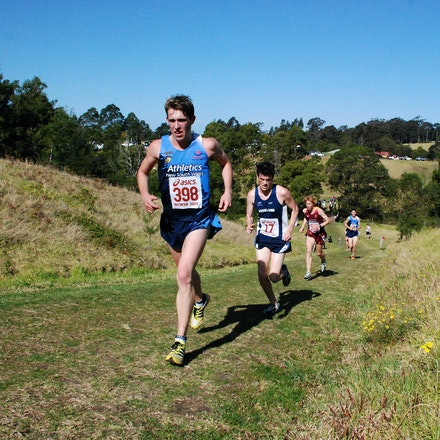 Todd Wakefield - Fourth across the line in the junior 8km race, but second Australian, Todd Wakefield works hard to climb one of the many hills on the...