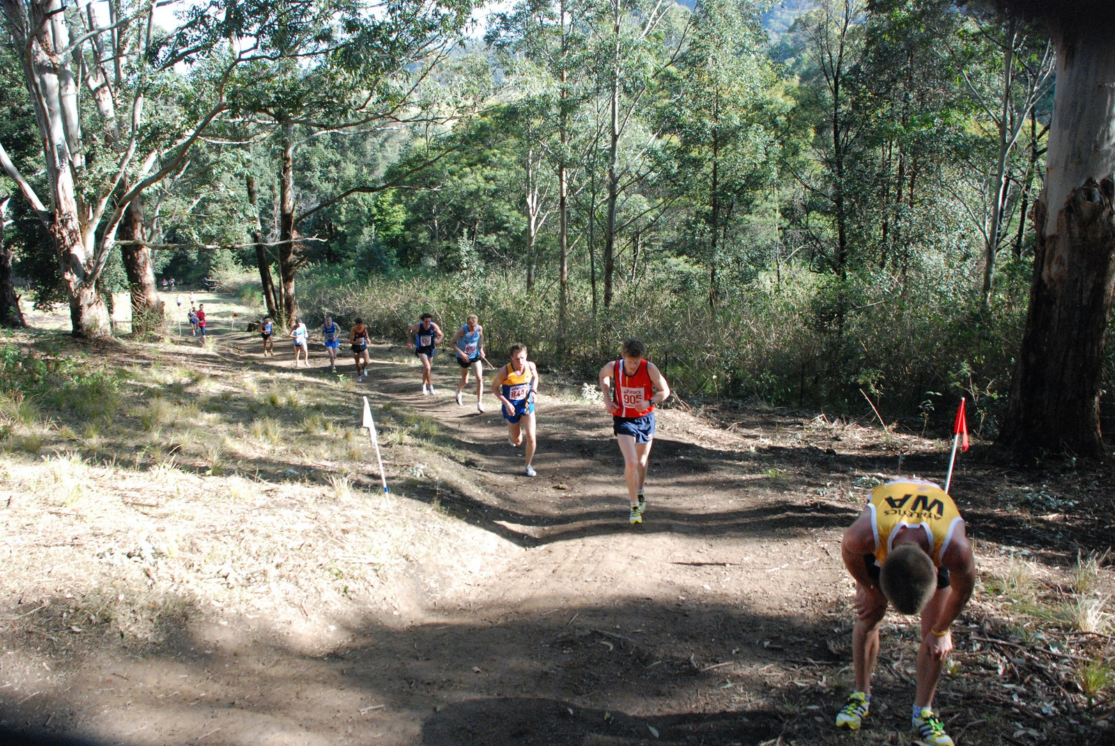 The Hill - A runner stops, exhausted, after climbing the hill which marks the halfway point of the 4km lap of the Willandra course which played host to...