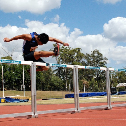 Hurdles - An athlete clears a hurdle at the 2009 Australian University Games on the Gold Coast.